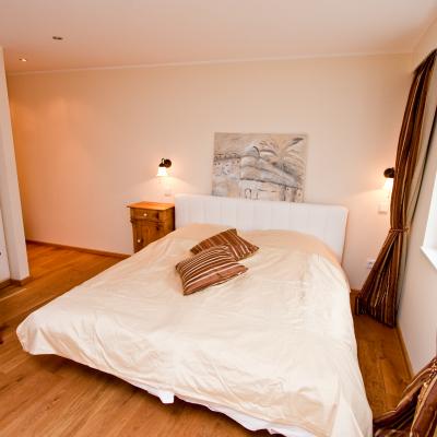 Das Zimmer Grace verfügt über ein freundliches Schlafzimmer mit individueller Note